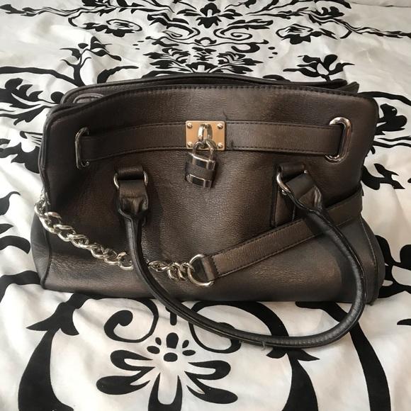 Charming Charlie Silver purse. $10